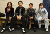 Four kid Elvis tribute artists mug for the camera in the dressing room. Along with two other young Elvi, the kids competed for the crown of best kid King.